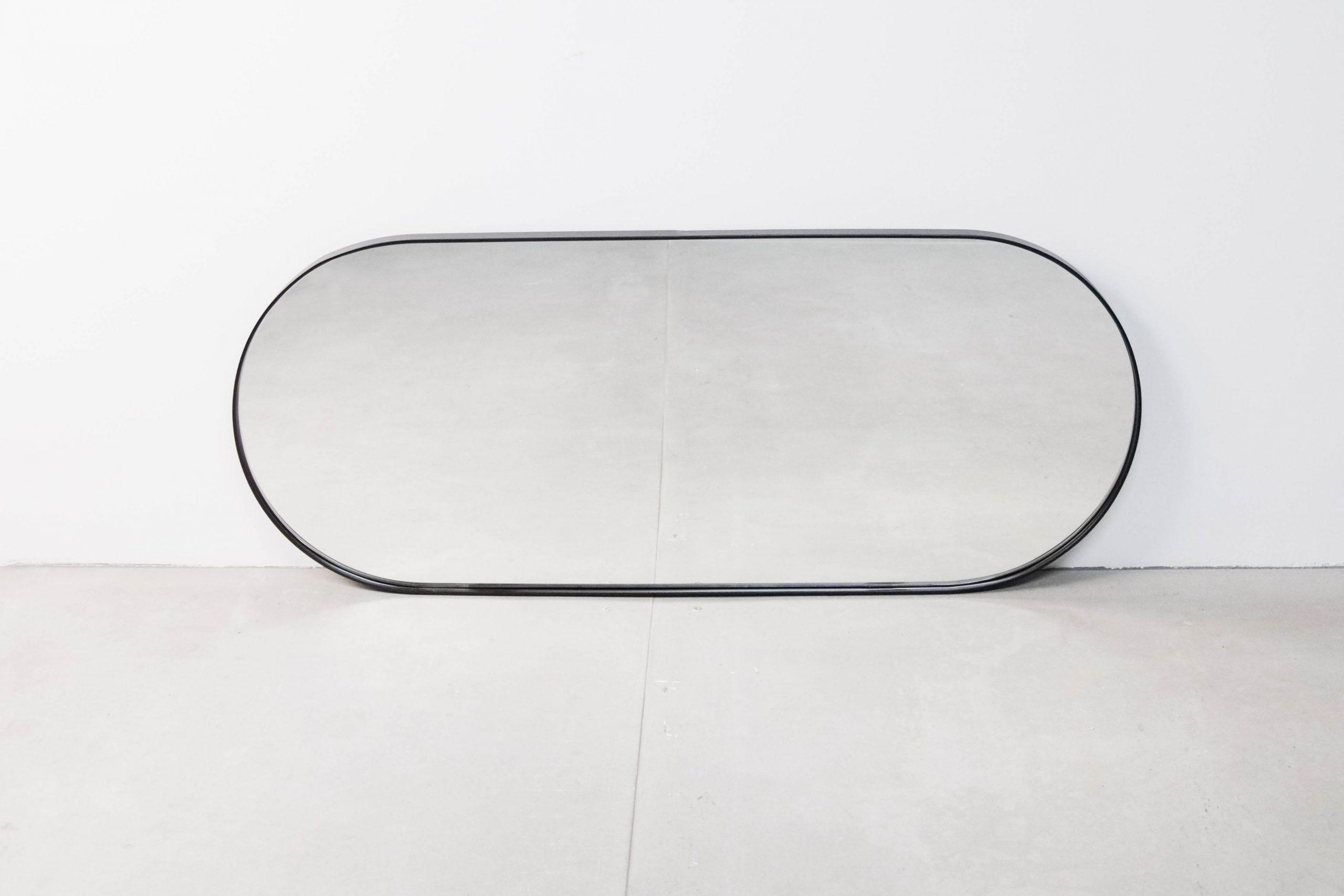 espejo redondeado pepita de oliva de metal ovalado de diseño