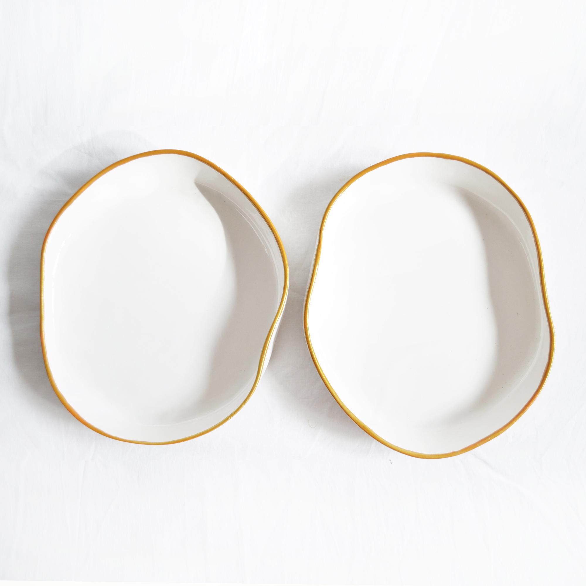 platos hondos blancos de diseño fabricados a mano redondeados irregulares