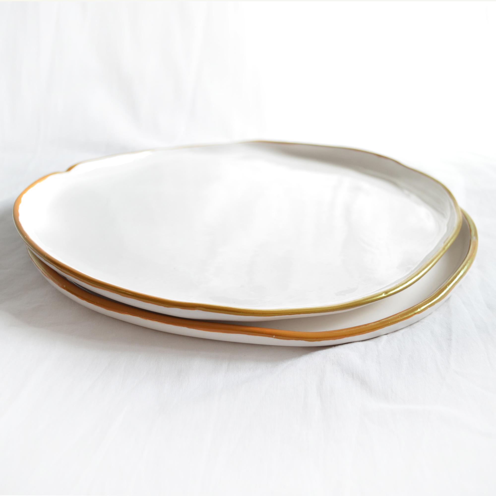 decoracion vajilla platos blancos dorados de calidad